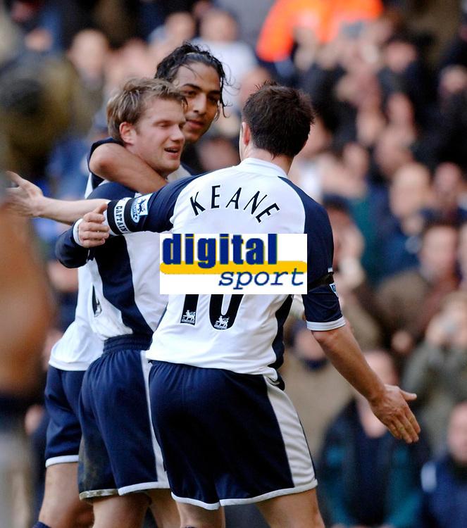 Photo: Daniel Hambury.<br />Tottenham Hotspur v Newcastle United. The Barclays Premiership. 31/12/2005.<br />Tottenham's Teemu Tainio celebrates scoring the first goal with team mates.