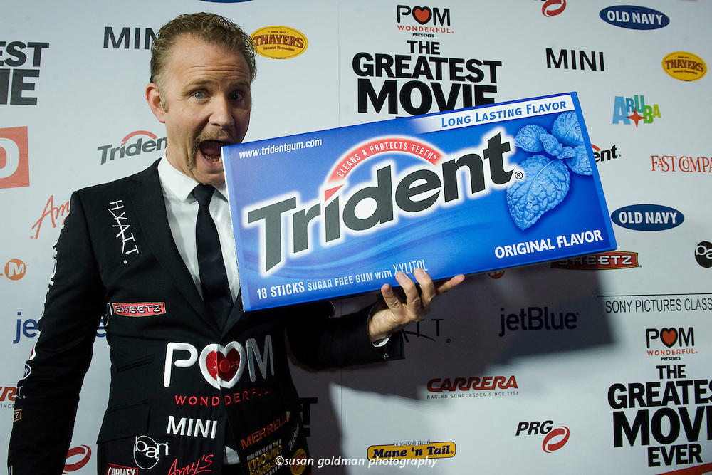 "An oversized package of Trident gum accompanies documentarian Morgan Spurlock on the red carpet at the premiere of his new film, ""The Greatest Movie Ever Sold"" in the Hollywood area of Los Angeles. The film is a playful yet thought provoking documentary examining the world of product placement, marketing and advertising, and yet is financed entirely by product placement, marketing and advertising. Photo/Trident, Susan Goldman."