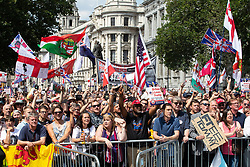 "© Licensed to London News Pictures. 14/07/2018. London, UK. Supporters of EDL founder Tommy Robinson ( real name Stephen Yaxley-Lennon ) and US President Donald Trump hold a "" Welcome Trump "" rally on Whitehall . Trump is currently in Scotland and Robinson is in HMP Hull . Photo credit: Joel Goodman/LNP"