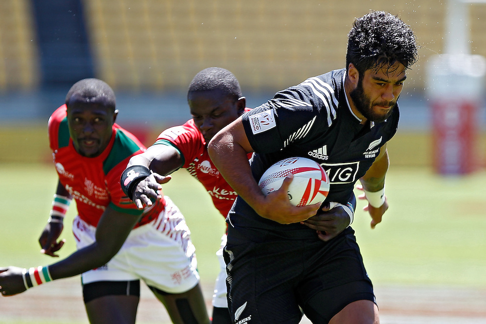 New Zealand's Akira Ioane, right, runs past Kenya players Kenya's Collins Injera, left and Andrew Amonde, centre, in the International Rugby Sevens Tournament at Westpac Stadium, Wellington, New Zealand, Sunday, January 31, 2016. Credit: SNPA / Dean Pemberton