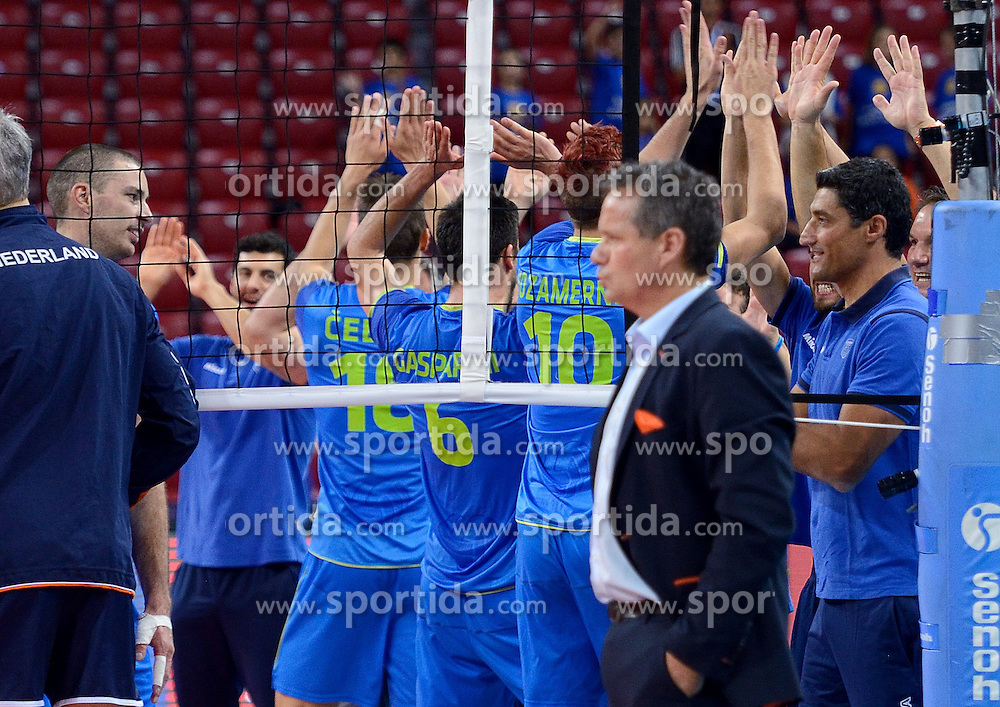 Coach Andrea Giani and players of Slovenia celebrate after winning during volleyball match between National teams of Netherlands and Slovenia in Playoff of 2015 CEV Volleyball European Championship - Men, on October 13, 2015 in Arena Armeec, Sofia, Bulgaria. Photo by Ronald Hoogendoorn / Sportida