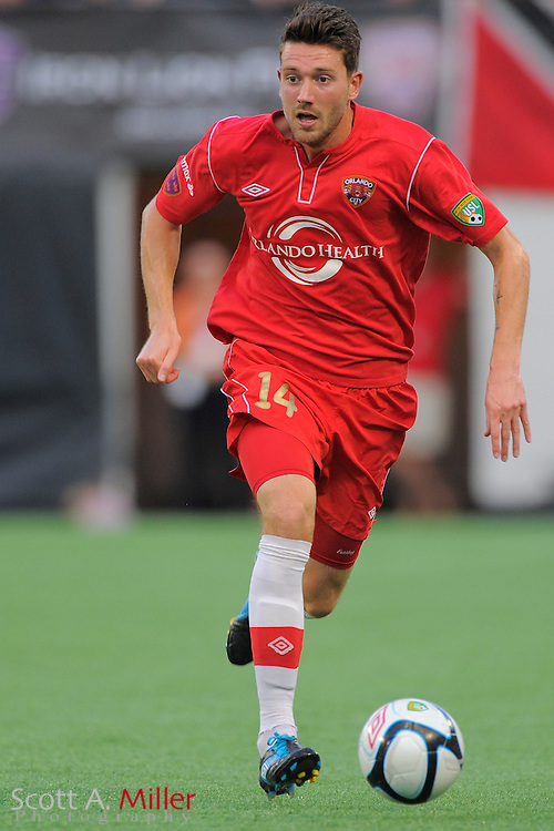 Orlando City Lions midfielder Luke Boden (14) during the Lions 4-0 win over the Charleston Battery at the Florida Citrus Bowl on July 27, 2012 in Orlando, Florida. The win clinched the USL-Pro regualr season title for Orlando...© 2012 Scott A. Miller..