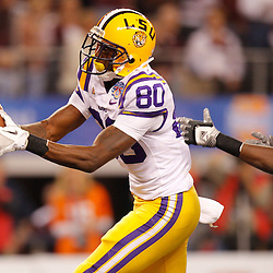 Jan 7, 2011; Arlington, TX, USA; LSU Tigers wide receiver Terrence Toliver (80) catches a touchdown over Texas A&M Aggies cornerback Terrence Frederick (7) during the first quarter of the 2011 Cotton Bowl at Cowboys Stadium.  Mandatory Credit: Derick E. Hingle