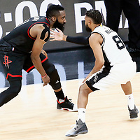 01 May 2017: San Antonio Spurs guard Patty Mills (8) defends on Houston Rockets guard James Harden (13) during the Houston Rockets 126-99 victory over the San Antonio Spurs, in game 1 of the Western Conference Semi Finals, at the AT&T Center, San Antonio, Texas, USA.