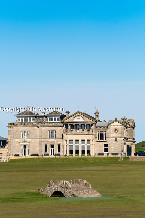 Exterior view of the club house of The Royal and Ancient Golf Club (R&A) and famous old Swilken Bridge over Swilken Burn on 18th Hole atOld Course in St Andrews, Fife, Scotland, UK.