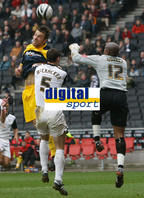 Photo: Steve Bond/Richard Lane Photography. MK Dons v Southampton. Coca-Cola Football League One. 20/03/2010. Rickie Lambert (L) gets above keeper Willy Gueret to score the first goal