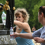 People filling up water at the fountain at Green Park, London, UK on July 19 2018.