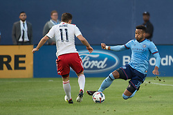 May 31, 2017 - New York City FC defender ETHAN WHITE (3) slides in for a tackle against New England Revolution midfielder KELYN ROWE (11) at Yankee Stadium in Bronx, NY. (Credit Image: © Mark Smith via ZUMA Wire)