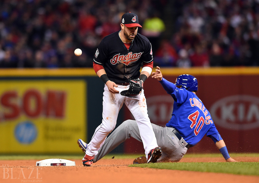 Oct 26, 2016; Cleveland, OH, USA; Cleveland Indians second baseman Jason Kipnis (left) commits an error allowing Chicago Cubs catcher Willson Contreras (40) to reach second base in the 7th inning in game two of the 2016 World Series at Progressive Field. Mandatory Credit: Ken Blaze-USA TODAY Sports