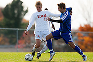 Mt. Anthony's Trey Lang (8) battles for the ball with CVU's Kyler White-Hansen (11) during the boys semifinal soccer game between Mount Anthony and Champlain Valley Union at CVU high school on Tuesday afternoon October 27, 2015 in Hinesburg. (BRIAN JENKINS/ for the FREE PRESS)