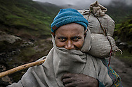 Farmer from the Northern Ethiopian Highlands during his long walk home in the rain.
