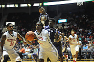 """Ole Miss Rebels guard Stefan Moody (42) goes for the ball against TCU Horned Frogs guard Chauncey Collins (1) and TCU Horned Frogs forward Chris Washburn (33) at the C.M. """"Tad"""" Smith Coliseum in Oxford, Miss. on Thursday, December 4, 2014. TCU won 66-54."""