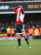 Brentford defender, Harlee Dean (6) looking unhappy with the loss during the Sky Bet Championship match between Brentford and Charlton Athletic at Griffin Park, London, England on 5 March 2016. Photo by Matthew Redman.