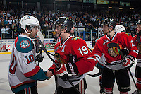 KELOWNA, CANADA - APRIL 25: Nick Merkley #10 of the Kelowna Rockets congratulates Nicolas Petan #19 of the Portland Winterhawks on the conference title on April 25, 2014 during Game 5 of the third round of WHL Playoffs at Prospera Place in Kelowna, British Columbia, Canada. The Portland Winterhawks won 7 - 3 and took the Western Conference Championship for the fourth year in a row earning them a place in the WHL final.  (Photo by Marissa Baecker/Getty Images)  *** Local Caption *** Nick Merkley; Nicolas Petan;