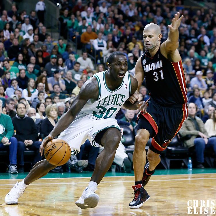27 January 2013: Boston Celtics power forward Brandon Bass (30) drives past Miami Heat small forward Shane Battier (31) during the Boston Celtics 100-98  2OT victory over the Miami Heat at the TD Garden, Boston, Massachusetts, USA.