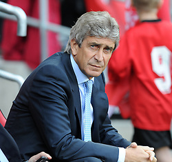 Manchester City Manager, Manuel Pellegrini  - Photo mandatory by-line: Alex James/JMP - Tel: Mobile: 07966 386802 25/08/2013 - SPORT - FOOTBALL - Cardiff City Stadium - Cardiff -  Cardiff City V Manchester City - Barclays Premier League