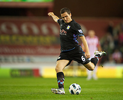 STOKE, ENGLAND - Monday, September 13, 2010: Aston Villa's Stuart Downing in action against Stoke City during the Premiership match at the Britannia Stadium. (Photo by David Rawcliffe/Propaganda)