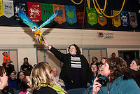 Kelly the Macaw delights the audience as she flies directly to Leia Fabian's hand and retrieves a five dollar bill during the Understanding Wildlife Show presented at Woodland Heights Elementary School Monday evening.  (Karen Bobotas/for the Laconia Daily Sun)