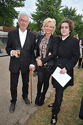 Left to right, MICHAEL WHITE, AMANDA ELIASCH and her son CHARLIE ELIASCH at the annual Serpentine Gallery Summer Party sponsored by Canvas TV  the new global arts TV network, held at the Serpentine Gallery, Kensington Gardens, London on 9th July 2009.