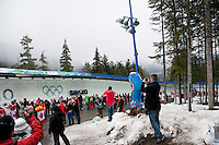 A crowd of spectators watch the 4-man bobsleigh finals at the Whistler Sliding Centre during the 2010 Olympic Winter Games in Whistler, BC Canada.