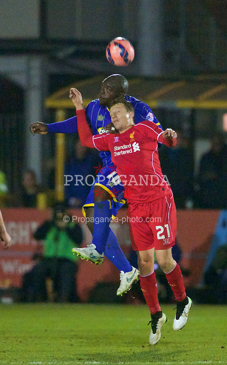 KINGSTON-UPON-THAMES, ENGLAND - Monday, January 5, 2015: Liverpool's Lucas Leiva in action against AFC Wimbledon's Adebayo Akinfenwa during the FA Cup 3rd Round match at the Kingsmeadow Stadium. (Pic by David Rawcliffe/Propaganda)