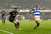 Aston Villa midfielder Robert Snodgrass (7) gets a cross in to the box past QPR Defender Jake Bidwell (3) during the EFL Sky Bet Championship match between Queens Park Rangers and Aston Villa at the Loftus Road Stadium, London, England on 18 November 2017. Photo by Andy Walter.