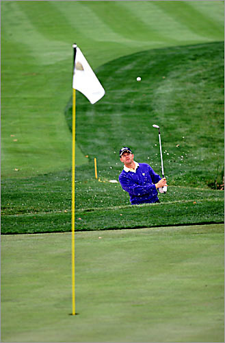 ernie els hits out of the sand at the robert trent jones golf club during the 2000 president's cup in virginia.