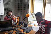 Palermo, centro d'accoglienza per minori non accompagnati Asanti, Numu originario del Gambia insieme a Maga della Guinea, nella sede della radio gestita dai ragazzi ospiti del centro.<br /> Palermo:  community house for unaccompanied foreign minors Asante, a non profit association,Numu  from Gambia and Maga from Guinea  in the radio space of the center managed by the young migrants