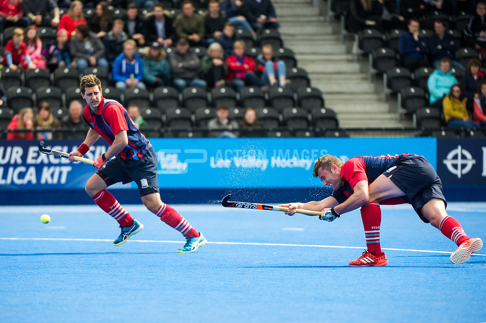 Hampstead & Westminster's Matt Guise-Brown shoots at a penalty corner. Wimbledon v Hampstead & Westminster - Semi-Final - Men's Hockey League Finals, Lee Valley Hockey & Tennis Centre, London, UK on 22 April 2017. Photo: Simon Parker