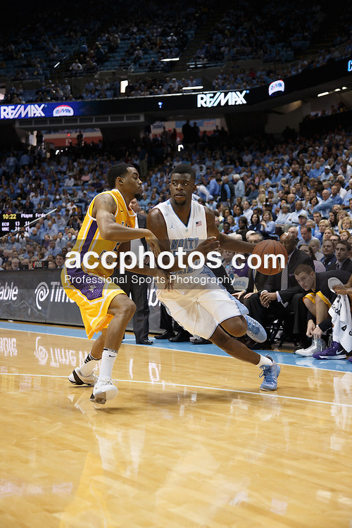 CHAPEL HILL, NC - DECEMBER 15: Reggie Bullock #35 of the North Carolina Tar Heels dribbles the ball during a game against the East Carolina Pirates on December 15, 2012 at the Dean E. Smith Center in Chapel Hill, North Carolina. North Carolina won 93-87.  *** Local Caption *** Reggie Bullock