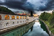 Backside of Market Colonnade and Ljubljanica River at dusk, Ljubljana, Slovenia