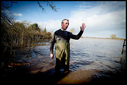 UKIP Leader Nigel Farage walks in the flood water  Burrowbridge, Somerset, United Kingdom. Sunday, 9th February 2014. Somerset has been flooded since the start of 2014, with people being forced to leave their homes. Picture by Andrew Parsons / i-Images