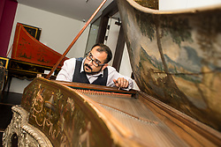 Conservator Jonathan Santa Maria Bouquet works on an ornate18th century harpsicord as part of the newly-refurbished St Cecilia's Hall, which has just undergone a 2 year, &pound;6.5 million refurbishment which will see more of the University of Edinburgh's musical instrument collection on display to the public.<br /> <br /> &copy; Dave Johnston/ EEm