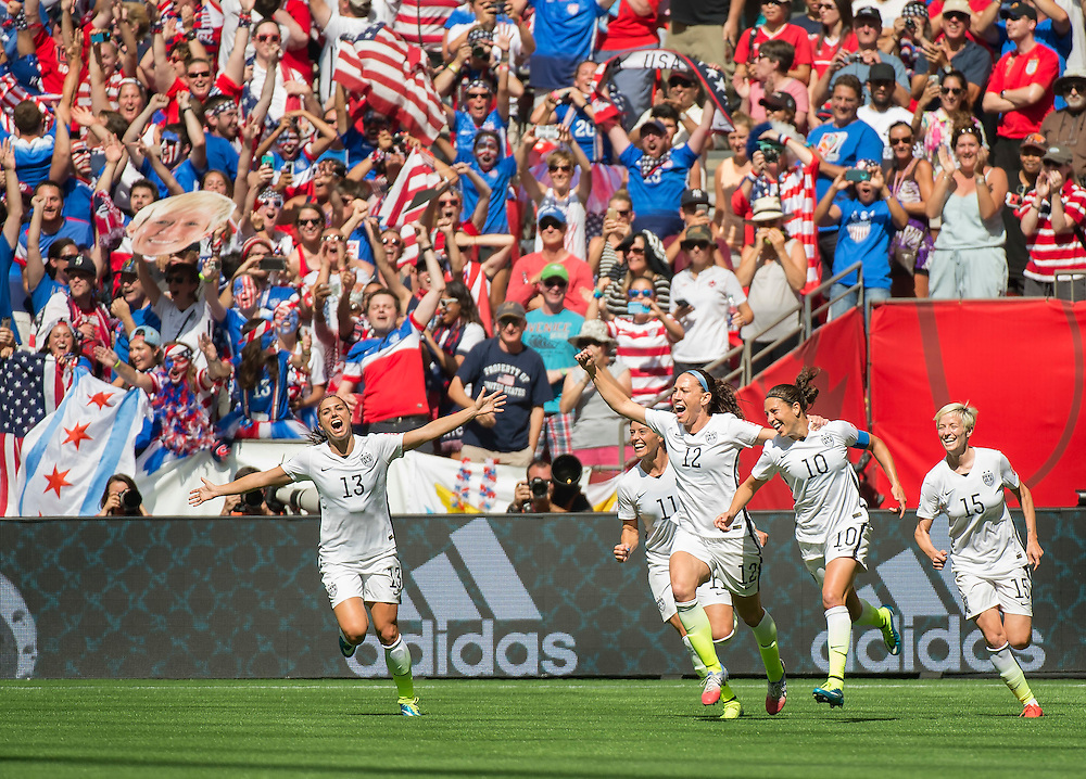 Alex Morgan (left #13) Alex Krieger (#11), Lauren Holiday (#12), Carli Lloyd (#10) and Megan Rapinoe of team USA celebrate Lloyd's second goal during 2015 women's World Cup Soccer in Vancouver during the final between USA and Japan.