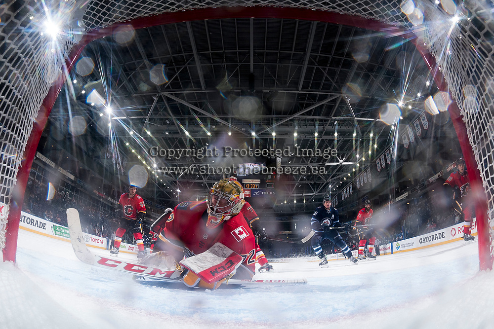 PENTICTON, CANADA - SEPTEMBER 11: Mason McDonald #72 of the Calgary Flames watches the puck behind the net after make a save against the Winnipeg Jets on September 11, 2017 at the South Okanagan Event Centre in Penticton, British Columbia, Canada.  (Photo by Marissa Baecker/Shoot the Breeze)  *** Local Caption ***