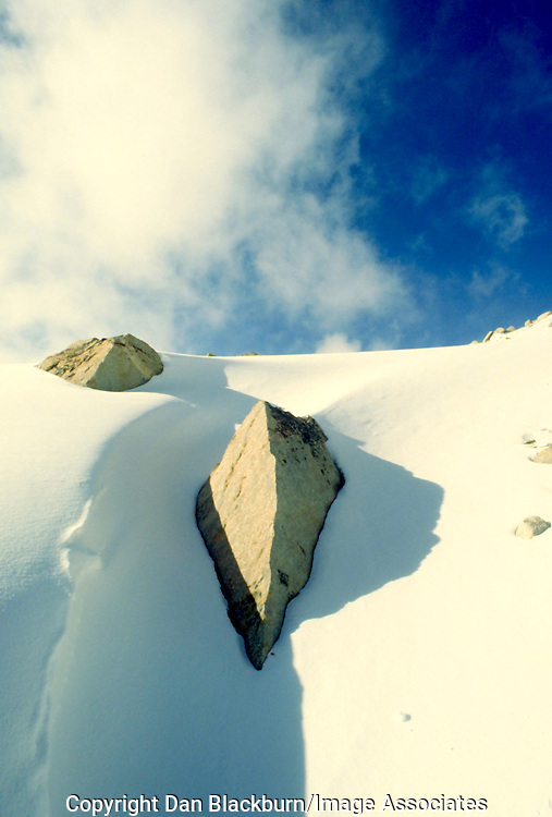 Granite boulders buried beneath the snow below Mt.Humphreys in Humpreheys Basin, Sierra Nevada, California