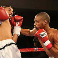 Marqus Jackson (R) punches Moises Carasquillo during a Telemundo boxing match at the Kissimmee Civic Center on Friday, July 17, 2015 in Kissimmee, Florida.  (AP Photo/Alex Menendez)