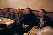 CZE_39_xs.Prague, Czech Republic. Peter Menzel, holding beer, and Craig Unger, on right, in a beer hall..