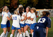 Coginchaug Regional High School celebrates after scoring the tying goal in over time 1-1 against Morgan High School at Coginchaug in Durham, CT. on Oct. 6, 2009.