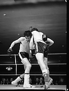 Nash vs Leon Championship Fight.    (N55)..1980..14.12.1980..12.14.1980..14th December 1980..At the Burlington Hotel, Dublin, Charlie Nash defended his European Lightweight Title when he took on Spain's Francesco Leon. .Image shows Leon trying to throw a right as Nash is held by his left.