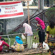 MARAWI, PHILIPPINES - JUNE 4: Displaced residents is seen getting water in a school grounds as temporary evacuation center in Municipality of Saguiaran, Lanao del Sur, Marawi City, Southern Philippines, June 4, 2017. Philippine troops and Marines continue to advance their positions as more soldiers reinforce to fight the Maute group in Marawi City, Mindanao, Philippines. (Photo: Richard Atrero de Guzman/ANADOLU Agency)
