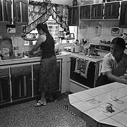 ANGELA JIMENEZ-CR roll 13 February 11, 1999<br />Lydia prepares breakfast before Kattia's first day of school.