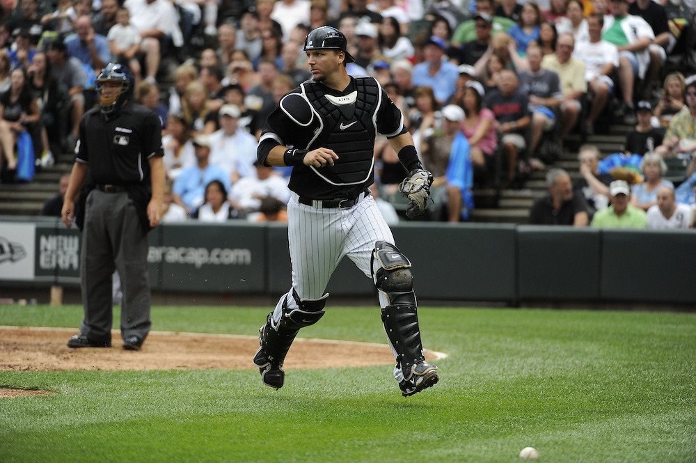 CHICAGO - JULY 10:  A.J. PIerzynski #12 of the Chicago White Sox runs after the ball during the game against the Kansas City Royals on July 10, 2010 at U.S. Cellular Field in Chicago, Illinois.  The White Sox defeated the Royals 5-1.  (Photo by Ron Vesely)