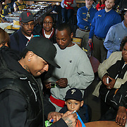 Philadelphia Sixers legend Allen Iverson signs a basketball for a young fan during a Delaware 87ers season ticket holders meet & greet Saturday, Apr. 05, 2014 at Buffalo wild wings in Wilmington, DEL.