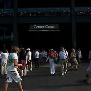 Spectators move outside centre court during the All England Lawn Tennis Championships at Wimbledon, London, England on Thursday, July 02, 2009. Photo Tim Clayton.