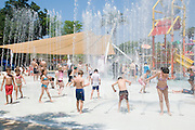Israel, Sfaim water Park, summer fun children playing in water jets