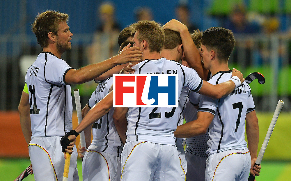 German players celebrate scoring a goal during the men's field hockey Canada vs Germany match of the Rio 2016 Olympics Games at the Olympic Hockey Centre in Rio de Janeiro on August, 6 2016. / AFP / Carl DE SOUZA        (Photo credit should read CARL DE SOUZA/AFP/Getty Images)