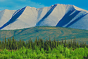 Dempster Highway, gravel road, at sunset in Ogilvie Mountains<br />