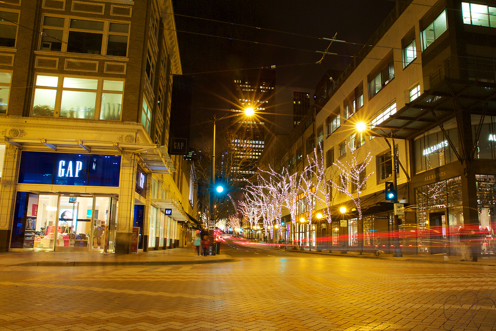 The intersection of 5th Ave and Pike St at night