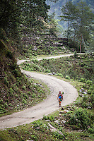 A local woman walking along the recently constructed road near the Annapurna Trail, Nepal.